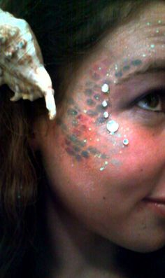 Mermaid costume Scales created by glitter glue and eyeshadow.. This website is the Pinterest of costumes