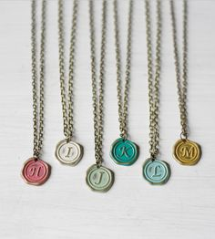 These are so adorable and would make great bridesmaids' gifts. :: Custom Initial Charm Necklace
