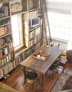 wooden bookshelves around window