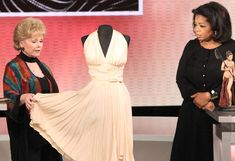Debbie Reynolds shows Oprah Billy Travilla's dress for Marilyn Monroe.   It later sold for just under 6 MILLION DOLLARS at Debbie's Profiles in History Auction.