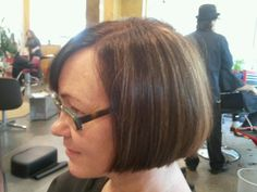 rich brown with peek a boo highlights classic chin length bob