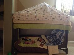 Re-purposed my son's pack n play into a reading/play nook. Best parts, didn't cost a dime and I can change the bedding and such to whatever he is into as he grows over the next few years.   Steps: Cut the mesh from one side of the pack in play. Fit sheet over bottom mat. (I like to add in extra blankets under the sheet for more comfort) Toss in pillow(s) and blanket/comforter. Place mobile over top and cover with fitted sheet.