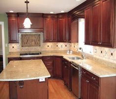 Lovely small kitchen. Note: Cherry Cabinet and the wood floor color.