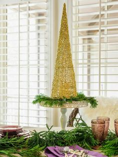 Great idea to use cake stand to decor in christmas.