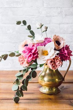 Lovely, handmade (by yours truly) felt flower arrangement, also available in an antique vase/pitcher. Real flowers only last a week or two, but these can last a special someone a very long time! Turnaround time is around 2-3 weeks, based on the amount of customization. Felt