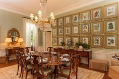 The dining room wall is lined with framed prints.  - CountryLiving.com