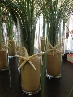 Bear Grass, Beach Sand, sea shell of any kind and cylinder vase.  For those last min dinners.  Yachtlife! Indigofloral.com