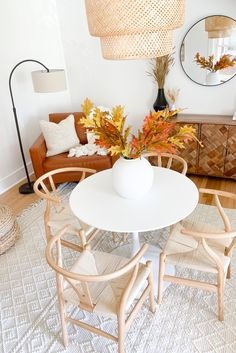 Ready for fall? Try a simple arrangement of fake fall leaves in a neutral, oversized vase. They'll create height and texture all while bringing in the tones of fall without the fuss of real fall leaves. Shop this look at Afloral.com. Image by @modernly_you.
