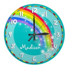 Fun kids rainbow name aqua wall clock. Colourful kids rainbow hues graphic wall clock. Customise with the short letter name of your choice, this example reads Madison. Would be a great personalised addition to your child's bedroom. Available in a range of other colors.