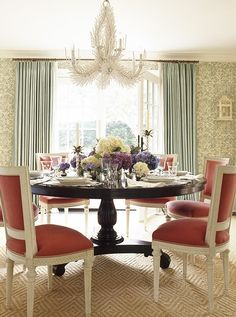 Designer Ashley Whittaker used a practical sisal carpet with an eye-catching diamond pattern to ground this dining space but not compete with the standout wallpaper and dining chairs. Photo byEric Piasecki.