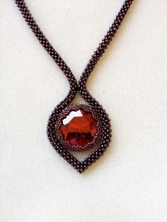 Simple, elegant necklace with bead-bezelled crystal.