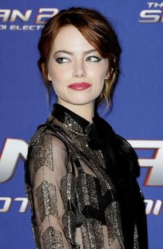 Emma Stone wearing bold makeup