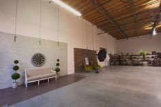 Huge warehouse space and creative studio offers flexibility for unique DIY events with one-of-the-kind props, warm decor, soaring ceilings and concrete floors.