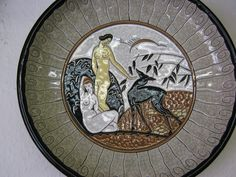 An original Art Deco LONGWY Wall charger C1925A very, very hard to find Longwy primavera wall charger Enamelled with two naked figures taming a young dear in a stylised landscape A truly iconic piece of Art Deco Provenance from the Albert E Wade collection