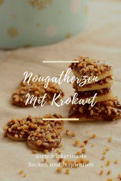 Nougatherzen sind ein einfaches und schnell gemachtes Weihnachtsplätzchen Rezept mit zartem Mürbeteig und leckerem Topping aus Nougat und Krokant.