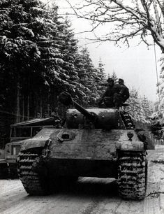A Panther tank rumbles forward in the Ardennes, late December 1944. Despite the strength of the 6th SS Panzer Army, it is ironic that the bulk of its units never got into combat. Because of the weather conditions and the wooded terrain, there were many bottlenecks that resulted in tanks being held up in massive jams.