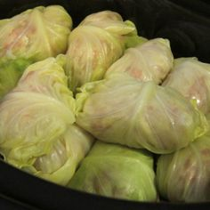 Paleo Cabbage Rolls - Ground beef or turkey, mixed with grated cauliflower and onion, rolled into boiled cabbage leaves and covered with crushed tomatoes. Slow cook for 5 hours, or baked for 90min on 350.