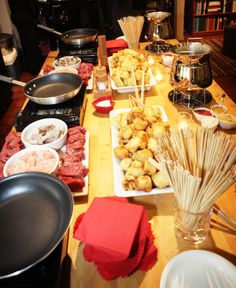 Fondue for a crowd - meat station, fruit and dessert station, and cheese and nut platter