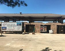 Car wash retrofitted into Meinieke Muffler shop by elevating roof