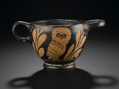 Glaux or skyphos (cup) of pottery decorated in red figure style with an owl between olive branches, with one vertical and one horizontal handle: Ancient Mediterranean, Ancient Greek, Attic, 5th century BC, c. 450 - 425 BC © National Museums Scotland