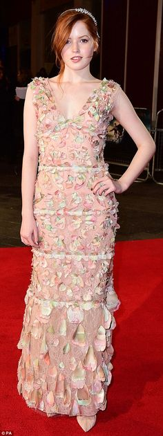 A tiered look: Ellie Bamber opted for a delicate pink ruffled number and chic high-heel shoes