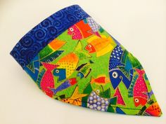 Whimsical Koi Fish swirl on this Yap Rap.  Designed for petite dogs, this neckwear will be striking on your little guy or gal. by CollarRap on Etsy