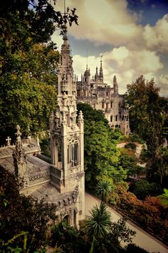 "Quinta da Regaleira, Sintra, Portugal  -  consists of a palace (known as the ""Palace of Monteiro the Millionaire), a chapel, and a luxurious park   -  built 1904-1910  -  architectural styles include Roman, Gothic, Renaissance and Manuelinea  -  hidden symbols in the buildings are believed to be related to alchemy, Masonry, the Knights Templar, and the Rosicrucians  -  UNESCO World Heritage Site"