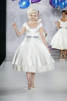 If you're going for a vintage look at your wedding, there's nothing more appropriate than a tea-length wedding dress. Popular in the 1950s, this style is super-feminine and whimsical.Gown byMatthew Christopher