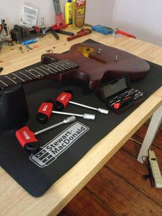 Learn how to setup your own guitar so it is ready to play, guitar setup, guitar building, Final Guitar Setup. Guitar Setup