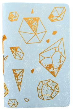 """Shitty Notebook, """"Crystal"""" features gold, shimmering gems scattered from front to back."""