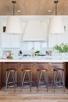 BECKI OWENS- 7 Elements of the Modern Farmhouse. White kitchen with warm rustic woods.