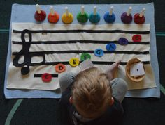 Montessori at Home: Music.   Handbells and DIY felt music sheet with notes & cards