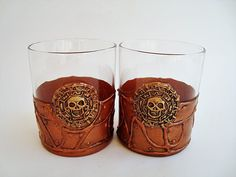 Steampunk Glasses, Glasses of Whiskey, Pirates Caribbean, Gothic Glasses, Pirate Skull, Pirate Glasspirate, Theme day of the Dead, bar glasses, pirate theme, day of the dead, Halloween glasses, gift for her  Unique handmade Koyna Peneva Two glasses of whiskey in the Gothic style. Color antique cooper Pirate emblem made by hand from clay material. Painted with acrylic paint and protected with varnish  ** I did a little change now and the bottom is colored.  volume 220ml. / 7,44 oz  Suitab...