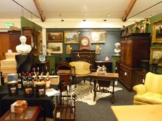 An interior view of the saleroom The Saleroom, Building, Interior, Table, Furniture, Home Decor, Decoration Home, Indoor
