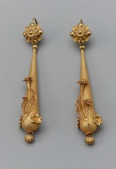 Earrings; 1800's. Long tear-shaped gilt drop decorated with three dimensional flowers and leaves. Small ball hangs at bottom. Drop attached to gilt rosettebutton.