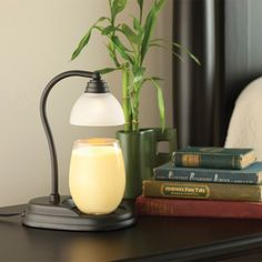 The patented Aurora Candle Warmer Lamp quickly melts the top of the candle to release the candle's fragrance and creates the ambiance of a burning candle without a flame. Available at www.candlewarmers.com