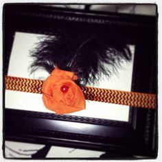Halloween inspired headband.  Handcrafted Orange Chiffon blossom accented with a pearl and black feather.  Completed with orange and black 5/8 elastic.   #pearlsNgirlsDesign www.etsy.com/shop/ILiveToLoveYou