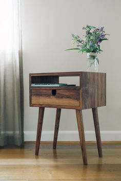 ** PLEASE NOTE. ALL ORDERS PLACED AFTER 20/4/2017 WILL NOT BE COMPLETED UNTIL MID TO LATE JULY, AS I WILL BE ON MY HONEYMOON UNTIL JULY 5th. I HOPE YOU UNDERSTAND** Simple, sophisticated bedside storage. Inspired by mid-century design, this walnut bedside borrows its slim legs and understated retro details from iconic 50s and 60s furniture. The dovetailed drawer on traditional wooden slides illustrates the quality of the build. Handmade in Melbourne, Australia. Solid walnut legs ...