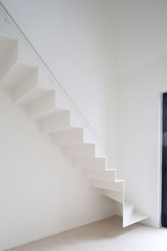 A thin metal staircase provides access to the renovated attic space of this…