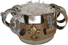 Use a bucket and wrap it with burlap.  Add a brass finding fleur de lis.   Perfect display for cuff bracelets!