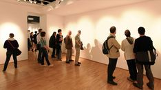 Art enthusiasts admire Newstrom's paintings and sculptures at the Schulberg Gallery in New York. (Nick Fabin)