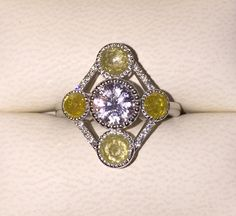 Raw rose cut Yellow Diamonds and natural white sapphire stone ring, Bohemian engagement ring, Wedding ring, Art Decon Inspired ring by BridalRings on Etsy https://www.etsy.com/listing/255921729/raw-rose-cut-yellow-diamonds-and-natural