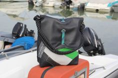Shoulde bag with flap made of #kitesurf #recycled #sail and leather. Unique piece #handmade in Italy #madeinitaly #creative
