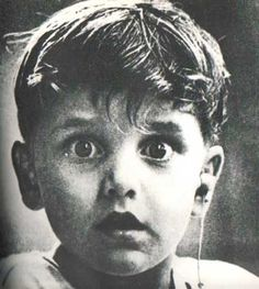 This photo was taken by photographer Jack Bradley and depicts the exact moment this boy, Harold Whittles, hears for the very first time ever. The doctor treating him has just placed an earpiece in his left ear. Date unknown.