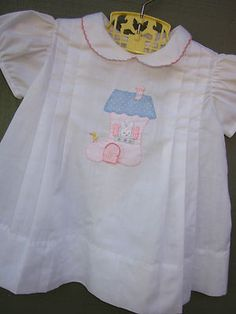 Vintage baby dress with pin tucks and sweet applique.