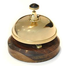 Brass Desk Bell with Wooden Base - This handy Brass Desk Bell is made from brass and given a polished finished. This desk bell not only looks great but sounds good too. Ideal to place in a shop so customers can alert you that they are waiting.