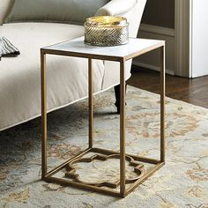 "Geometric Side Table Geometrics are in. Our petite Geometric Side Table is crafted of iron with an elegant marble top and quatrefoil base for a subtle graphic touch. Line three in a row for a rectangular coffee table or use four to create a square one.  Geometric Side Table features: Aged Gold finish Marble is a natural material and will have delightful variations. Dimensions: Overall: 18""H X 12"" Square"