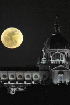The spectacular Supermoon (or Superluna) behind La Catedral de la Almudena, Madrid, Spain.