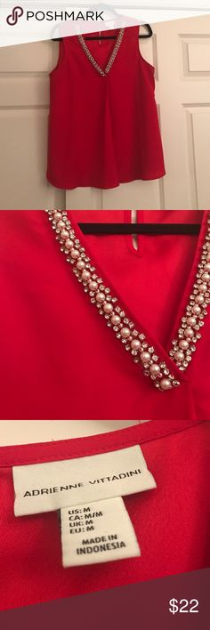 Beautiful red vneck top Pearl and diamond accented shirt! Deep vneck! Only worn once! In excellent condition! Size medium Adrienne Vittadini Tops