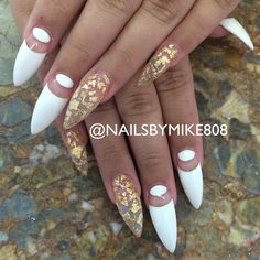 These nails are perfect.White with gold foil stiletto nails